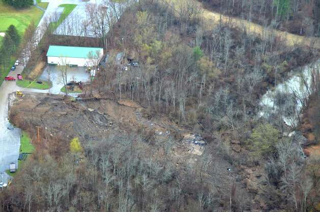 View from a state police helicopter of the mudslide into the Normans Kill on Monday, April 20, 2015 in Delmar, N.Y. The Normanside Country Club is seen at left. (Courtesy of New York State Police Department) Photo: Lori Van Buren