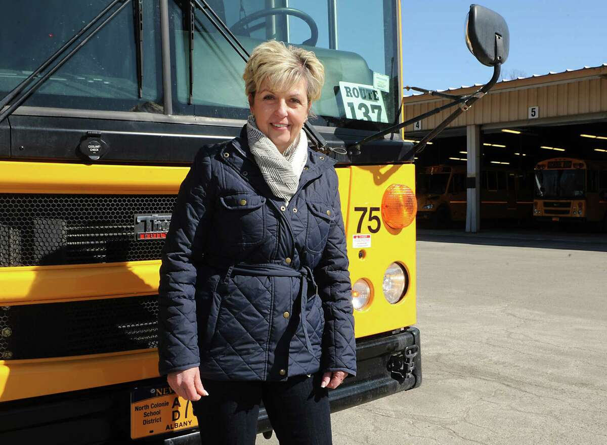 Bus driver Patty Mitchell stands in front of the school bus she drives on Monday, March 23, 2015 in Latham, N.Y. (Lori Van Buren / Times Union)