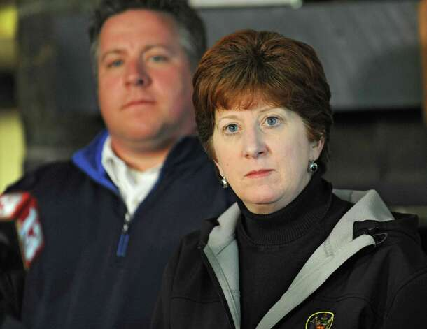 Albany Mayor Kathy Sheehan listens to a question regarding the landslide into the Normans Kill during a press conference at the Capital Hills at Albany golf course in the Norman Kill on Monday, April 20, 2015 in Albany, N.Y. Albany County Executive Dan McCoy stands behind her. (Lori Van Buren / Times Union) Photo: Lori Van Buren