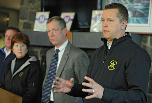 Albany sheriff Craig Apple Sr. answers questions regarding the landslide into the Normans Kill during a press conference at the Capital Hills at Albany golf course in the Norman Kill on Monday, April 20, 2015 in Albany, N.Y. From left behind him are Albany County Executive Dan McCoy, Albany Mayor Kathy Sheehan and Bethlehem Supervisor John Clarkson. (Lori Van Buren / Times Union) Photo: Lori Van Buren