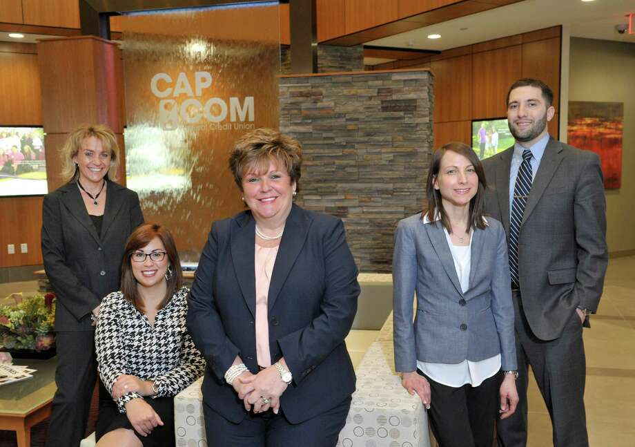 CapCom employees, from left to right, Candace Stazio, loan originator, Amanda Goyer, foundation and public relations administrator, Paula Stopera, president and CEO, Theresa Trietiak, director of H.R., and Brian Hooks, license branch representative, pose for a photograph at the CapCom Federal Credit Union on Monday, March 30, 2015, in Albany, N.Y.   (Paul Buckowski / Times Union) Photo: PAUL BUCKOWSKI / 00031021A