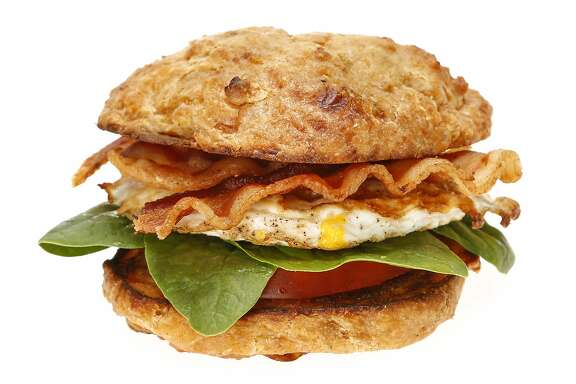 A Cheddar Chiptole Scone with tomato, spinach, egg and bacon, a recipe from L'Acajou Bakery and Cafe, is seen on Monday, April 20, 2015 in San Francisco, Calif.