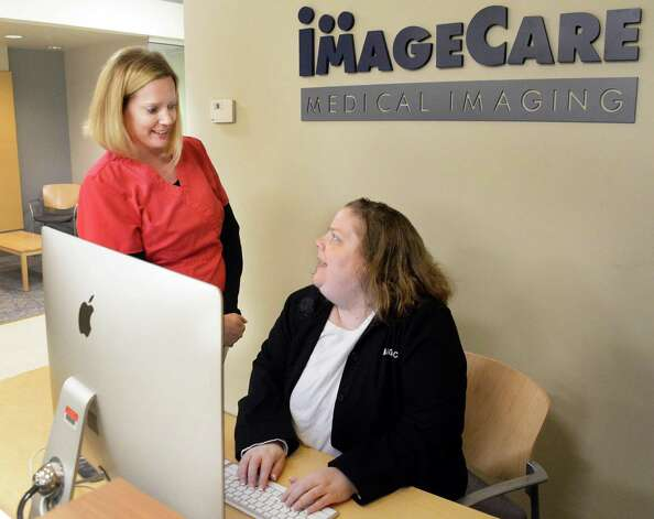 Secretary supervisor Lindsey Ogden, left, and medical secretary Amy Griswold in the reception area at ImageCare Medical Imaging Latham Friday March 27, 2015 in Colonie, NY.  (John Carl D'Annibale / Times Union) Photo: John Carl D'Annibale / 00031183A