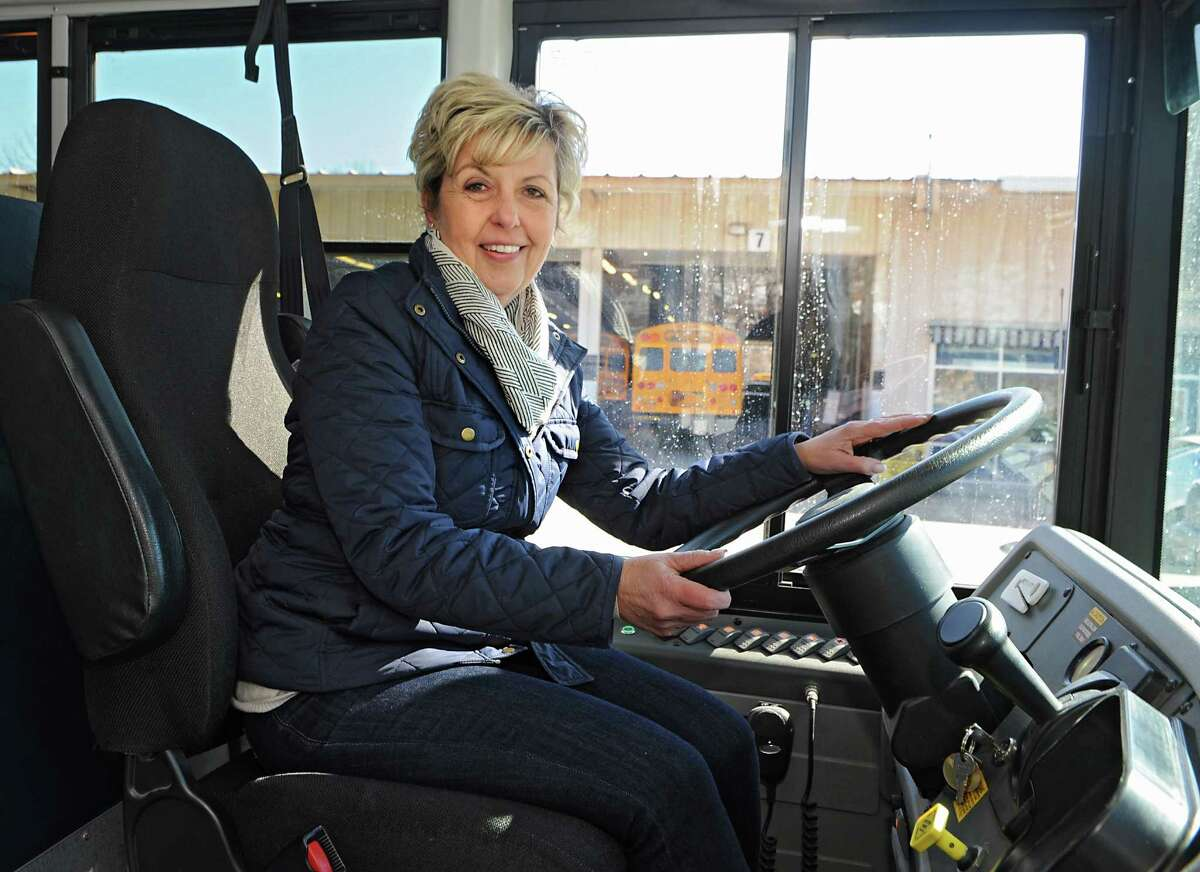 Bus driver Patty Mitchell sits in the driver's seat on the school bus she drives on Monday, March 23, 2015 in Latham, N.Y. (Lori Van Buren / Times Union)
