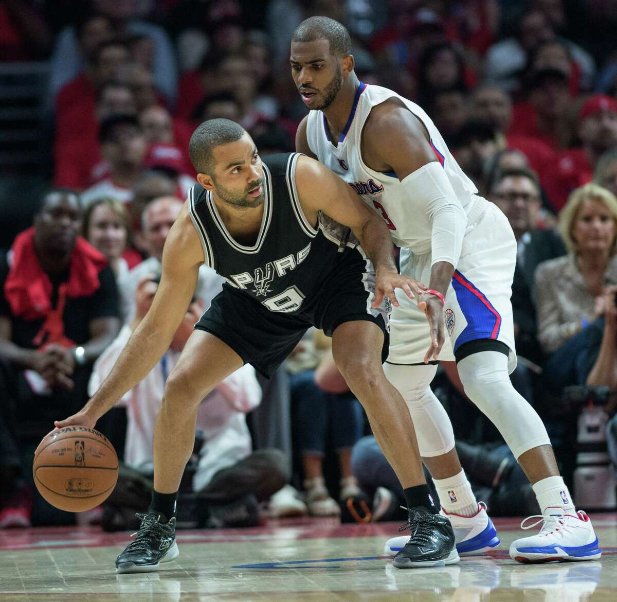 The Clippers' Chris Paul defends the Spurs' Tony Parker during the first half of Game 1.