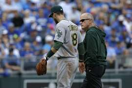 Oakland Athletics second baseman Ben Zobrist (18) leaves injured during a baseball game against the Kansas City Royals at Kauffman Stadium in Kansas City, Mo., Sunday, April 19, 2015. (AP Photo/Orlin Wagner)