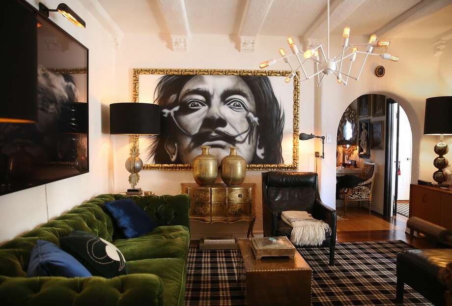 The living room of Restoration Hardware's Executive Creative Director Gary Spain's San Francisco apartment includes a large painting of Salvador Dalí by Randy Rivera. Photo: Liz Hafalia, The Chronicle