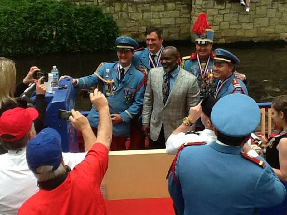 Emmitt Smith of Dallas Cowboys fame poses for photos at Texas Cavaliers River Parade. Photo: Vincent Davis/Express-News