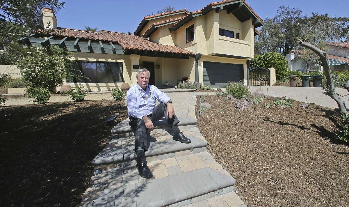 In this April 17, 2015 photo, Jim Reardon, who iss awaiting a ruling from a California appeals court regarding his suit over tiered water rates, stands outside his home where he installed drought-tolerant landscaping in San Juan Capistrano, Calif. The appeals court has ruled that the city's tiered water-rates are unconstitutional on Monday, April 20. (AP Photo/Lenny Ignelzi)
