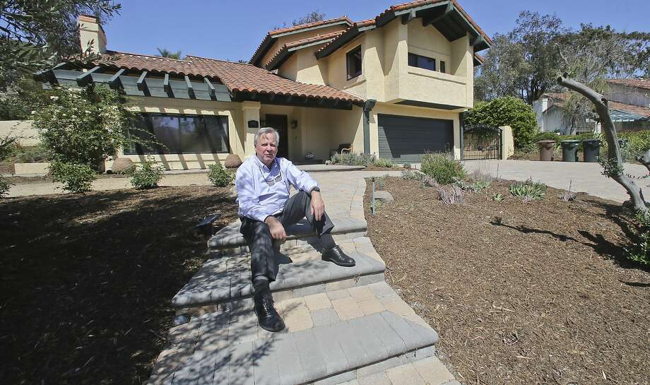 In this April 17, 2015 photo, Jim Reardon, who iss awaiting a ruling from a California appeals court regarding his suit over tiered water rates, stands outside his home where he installed drought-tolerant landscaping in San Juan Capistrano, Calif. The appeals court has ruled that the city's tiered water-rates are unconstitutional on Monday, April 20. (AP Photo/Lenny Ignelzi) Photo: Lenny Ignelzi, Associated Press