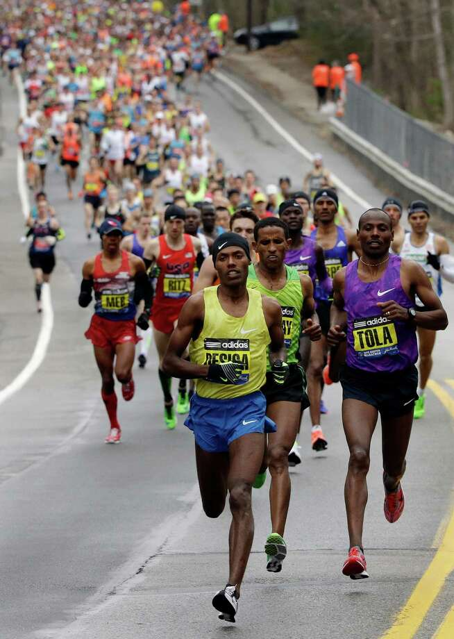 Lelisa Desisa, of Ethiopia, leads the pack through Hopkinton, Mass., en route to a win in the Boston Marathon, Monday, April 20, 2015, in Boston. (AP Photo/Steven Senne) ORG XMIT: BXM136 Photo: Steven Senne / AP