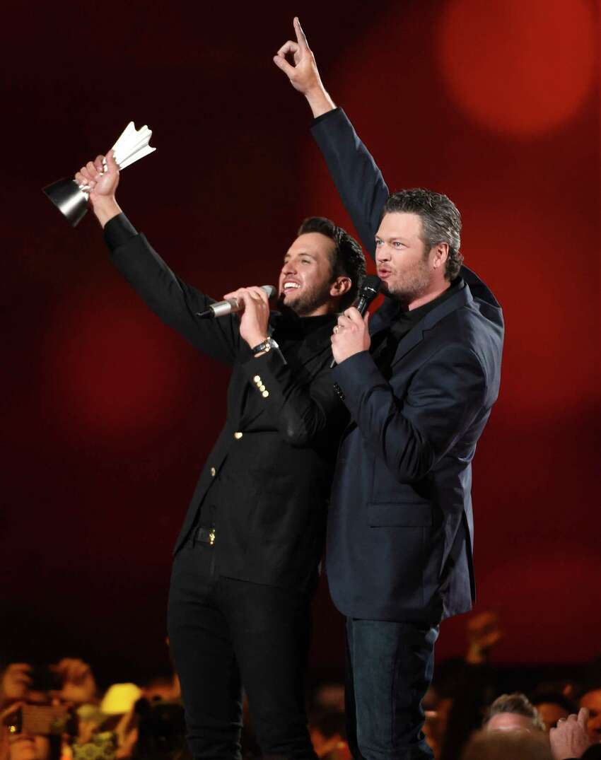 Luke Bryan, left, and Blake Shelton speak on stage after Bryan accepts the award for entertainer of the year at the 50th annual Academy of Country Music Awards at AT&T Stadium on Sunday, April 19, 2015, in Arlington, Texas. (Photo by Chris Pizzello/Invision/AP) ORG XMIT: TXBR352