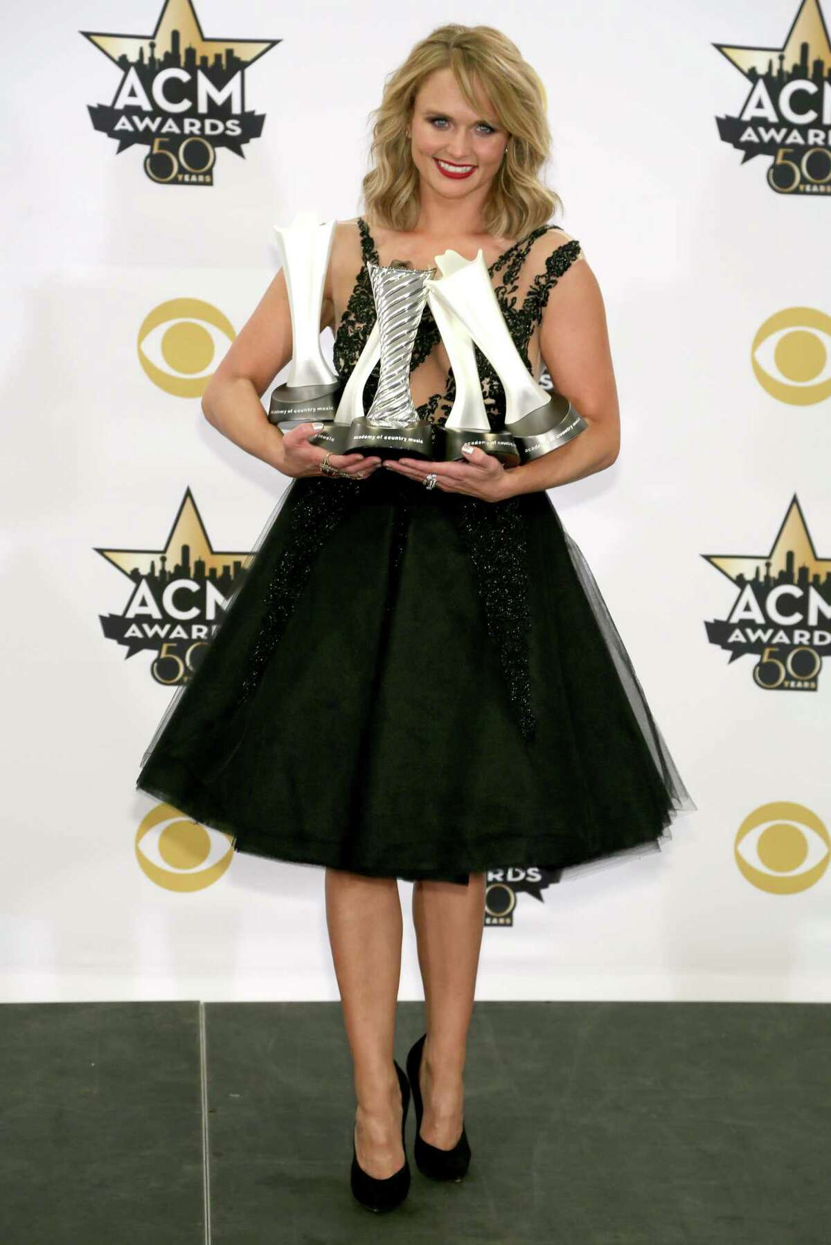 Miranda Lambert poses in the press room with the milestone award and the awards for song of the year for