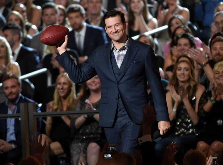 Tony Romo walks on stage at the 50th annual Academy of Country Music Awards at AT&T Stadium on Sunda