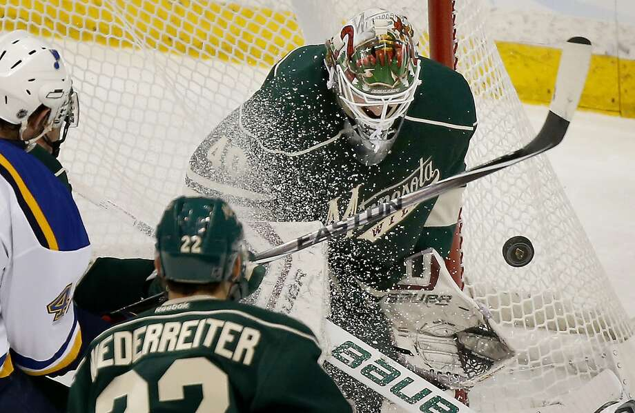 Wild goalie Devan Dubnyk turns aside a first-period shot, one of his 17 saves in his first career postseason shutout. Photo: Carlos Gonzalez, McClatchy-Tribune News Service