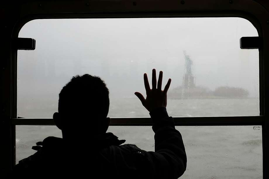 A man looks out at the Statue of Liberty in the rain and fog from the Staten Island Ferry on April 20, 2015 in New York City. Much of the East Coast experienced heavy rains and high winds following a beautiful spring weekend. Photo: Spencer Platt, Getty Images