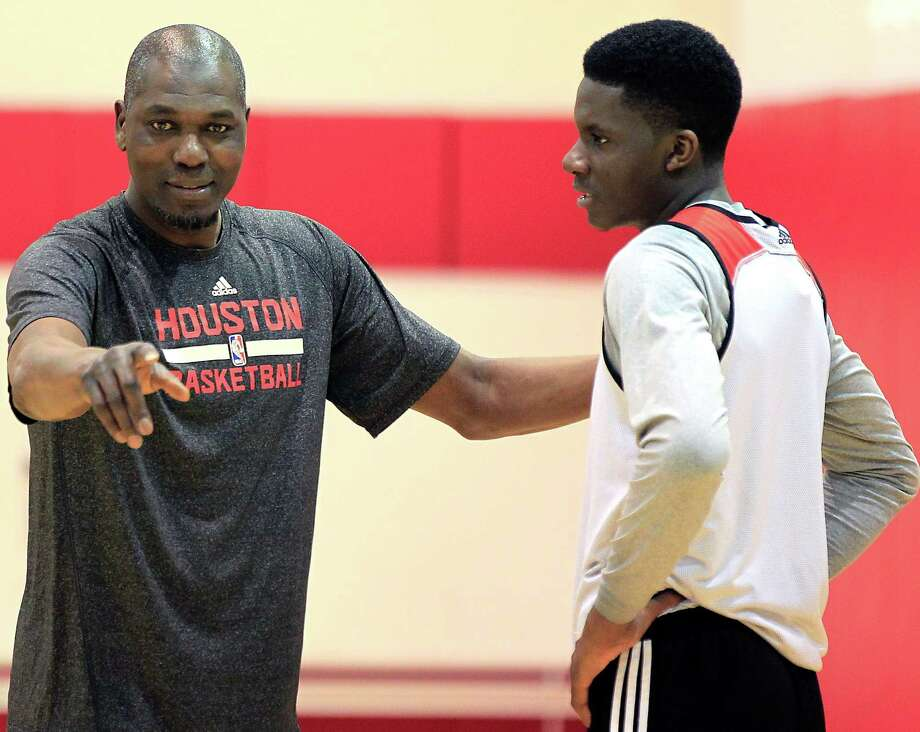 Hakeem Olajuwon left, works with Clint Capela after Monday's practice. Photo: James Nielsen, Staff / © 2015  Houston Chronicle