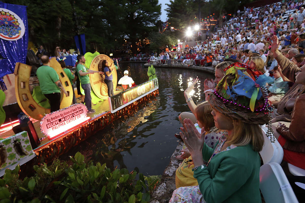 Wearing a hat made by herself, Nancy Nell Fry, 9, watches the Texas Cavaliers River Parade at the Arneson River Theater, Monday, April 20, 2015. The annual event drew thousands to the San Antonio River Walk and is one of three parades featured for Fiesta, a highlight event for a city that loves to party.