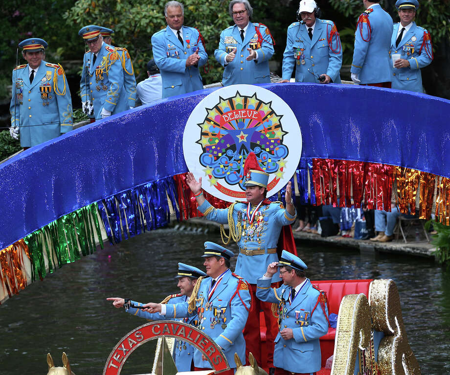King Antonio XCIII Mark M. Johnson, Jr. waves to the crowd as he arrives at the Arneson River Theater to kick off the Texas Cavaliers River Parade, Monday, April 20, 2015. Photo: JERRY LARA, San Antonio Express-News / © 2015 San Antonio Express-News
