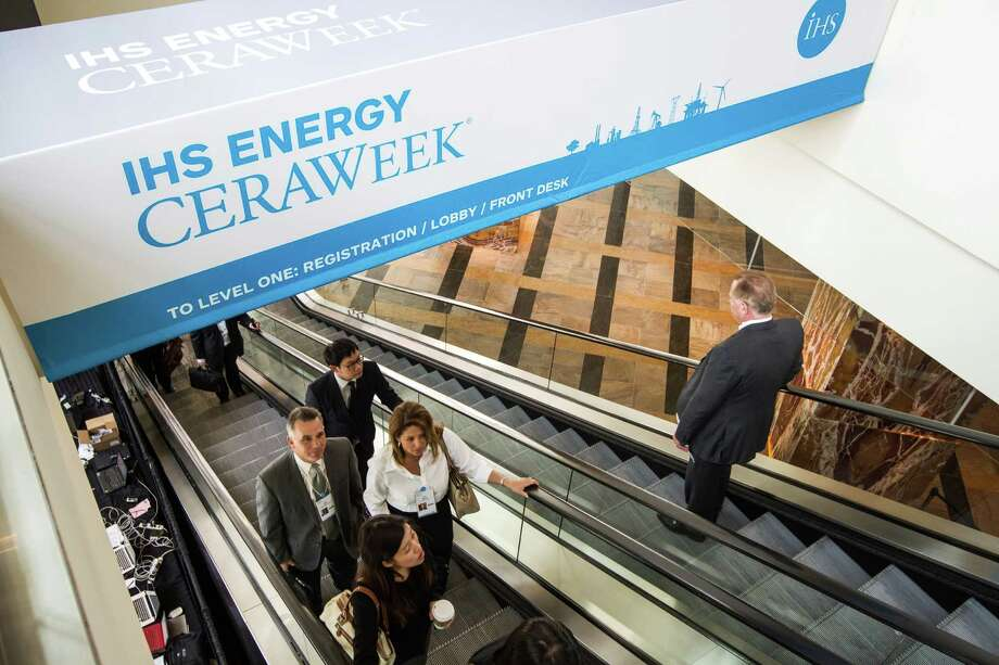 Delegates to IHS Energy CERAWeek arrive Monday for the opening panel discussion. About 2,800 attendees are looking to the five-day summit for insight on navigating oil's bear market. Photo: Brett Coomer, Staff / © 2015 Houston Chronicle