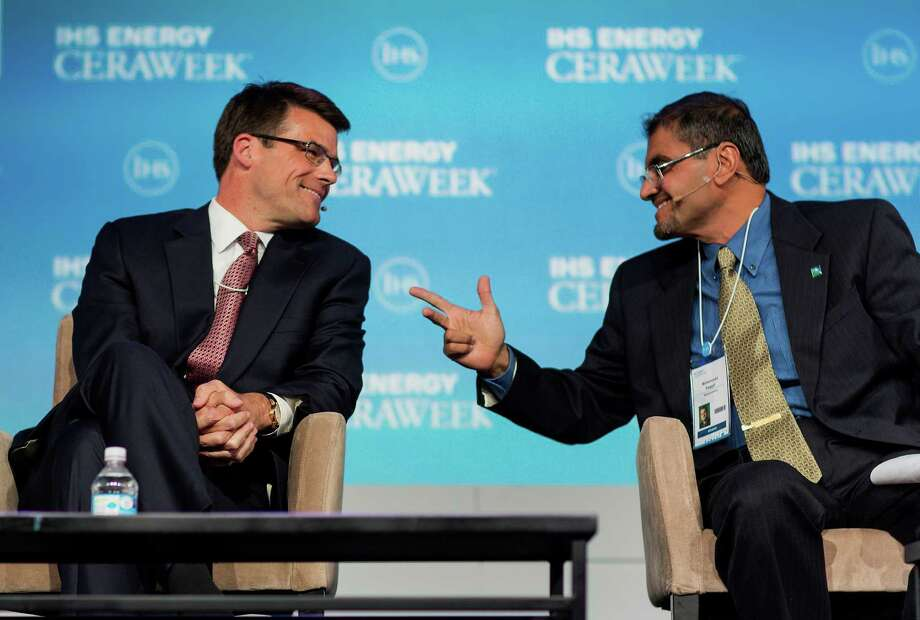 Steve Bolze, chief executive officer of GE Power & Water, left, speaks with Muhammad Al-Saggaf, acting head of shared operations and services for Saudi Aramco, at the 2015 IHS CERAWeek conference in Houston, Texas, U.S., on Monday, April 20, 2015. CERAWeek 2015, in its 34th year, will provide new insights and critically-important dialogue with decision-makers in the oil and gas, electric power, coal, renewables, and nuclear sectors from around the world. Photographer: F. Carter Smith/Bloomberg *** Local Caption *** Steve Bolze; Muhammad Al-Saggaf Photo: F. Carter Smith / © 2015 Bloomberg Finance LP