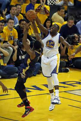 Golden State Warriors' Draymond Green blocks a shot by New Orleans Pelicans' Tyreke Evans in 2nd quarter during Game 2 of the 1st Round of NBA Western Conference Playoffs at Oracle Arena in Oakland, Calif., on Monday, April 20, 2015.