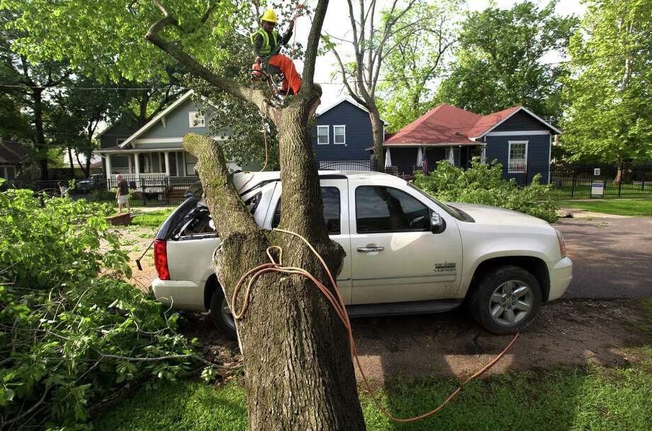 Insurers were bracing for many claims for storm damage, like this scene in the Heights, but the claims reporting wasn't as intense as expected. Photo: Cody Duty, Staff / © 2015 Houston Chronicle