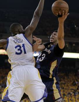 Anthony Davis (23) shoots while defended by Festus Ezeli (31) during the first half. The Golden State Warriors played the New Orleans Pelicans in Game 2 of the 1st Round of NBA Western Conference Playoffs at Oracle Arena in Oakland, Calif., on Monday, April 20, 2015.
