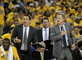 Head coach Steve Kerr and coach Luke Walton question a call after Klay Thompson was pulled out of bounds during the first half. The Golden State Warriors played the New Orleans Pelicans in Game 2 of the 1st Round of NBA Western Conference Playoffs at Oracle Arena in Oakland, Calif., on Monday, April 20, 2015.