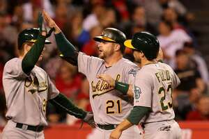 Down a man, A's use homers, Otero to beat Angels - Photo