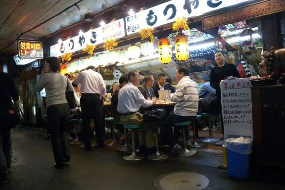 One of the best places to mingle with locals at night is under the tracks of the Yamanote Line near Yurakucho Station. Just behind Tokyo Takarazuka Theater, in a tunnel-like passageway linking the Hibiya and Ginza districts, is a string of no-frills places ilke this one. The specialty at this establishment is motsuyaki, or grilled chicken and pork livers.