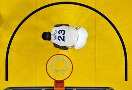Draymond Green (23) ties his shoe during the second half. The Golden State Warriors played the New Orleans Pelicans in Game 2 of the 1st Round of NBA Western Conference Playoffs at Oracle Arena in Oakland, Calif., on Monday, April 20, 2015.