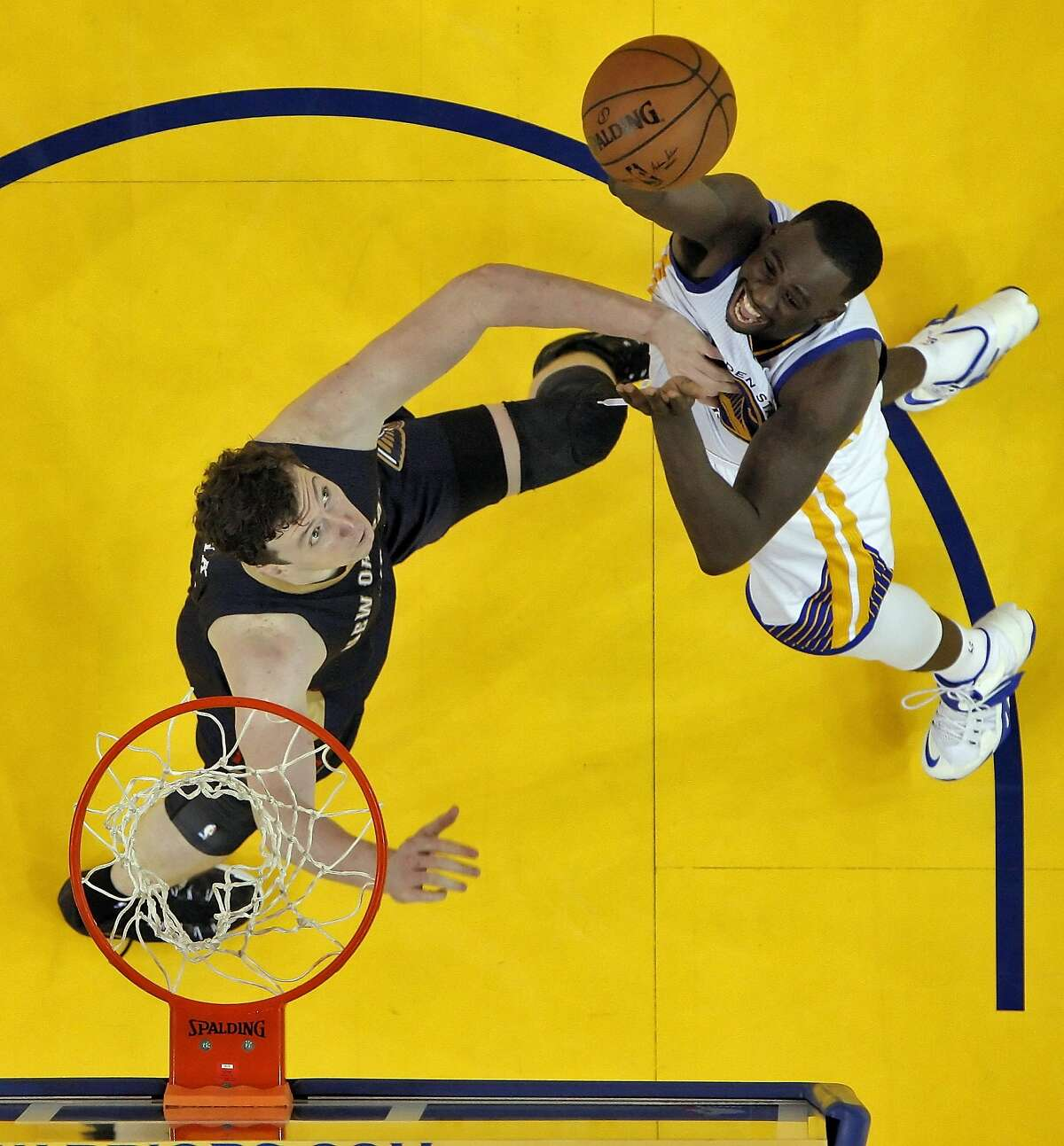 Draymond Green (23) shoots over Omer Asik (3) during the second half. The Golden State Warriors played the New Orleans Pelicans in Game 2 of the 1st Round of NBA Western Conference Playoffs at Oracle Arena in Oakland, Calif., on Monday, April 20, 2015.