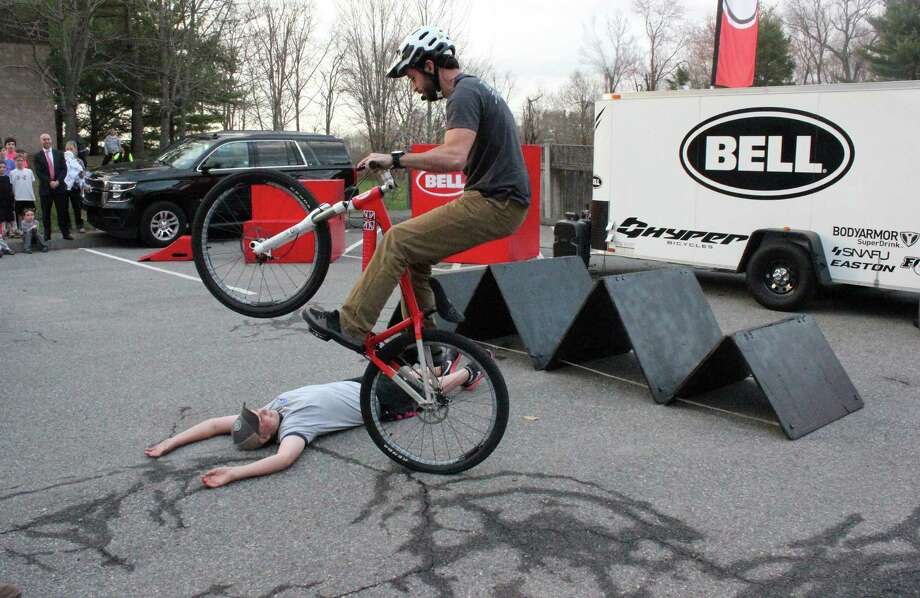 The New Canaan YMCA's recent Family Dinner Night included a mountain bike stunt show performed by Chris Clark. Photo: Contributed Photo / New Canaan News