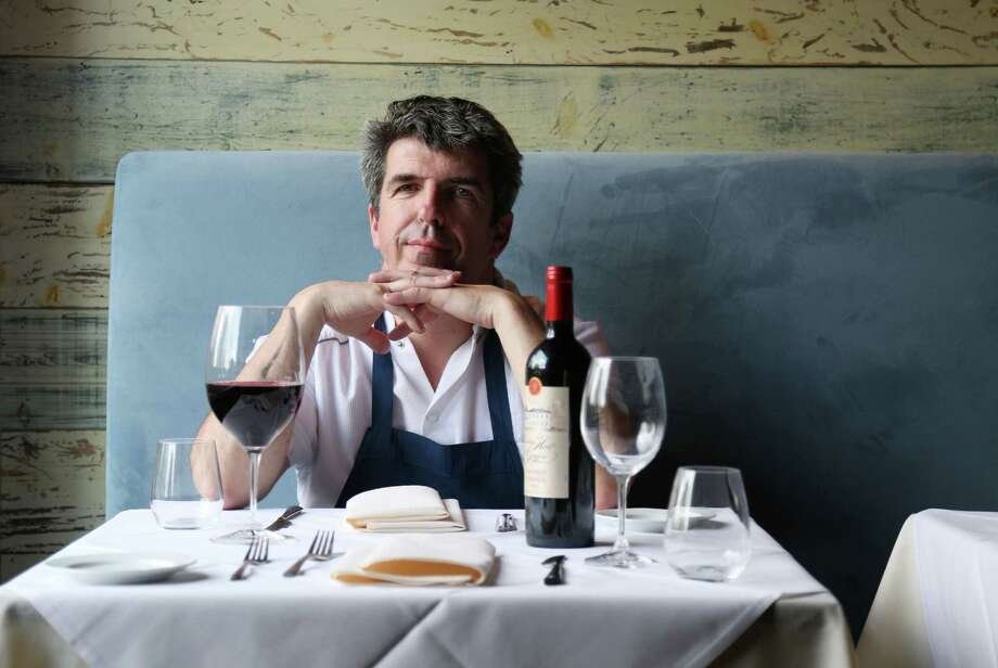 Philippe Verpiand poses for a portrait with a glass of Chateau Haut-Goujon Lelande de Pomerol, 2010, at Etoile Thursday, April 16, 2015, in Houston. ( Jon Shapley / Houston Chronicle ) Photo: Jon Shapley, Staff / © 2015 Houston Chronicle