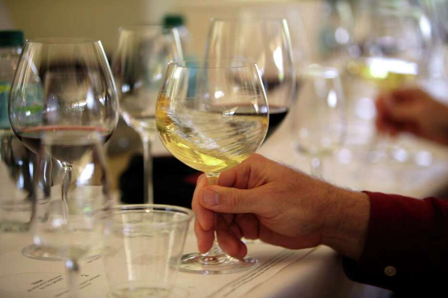 "More than two dozen California vintners are facing a lawsuit claiming their wines contain dangerously high levels of arsenic. The industry group Wine Institute dismissed the allegations as ""false and misleading."" Photo: Eric Risberg, STF / AP"