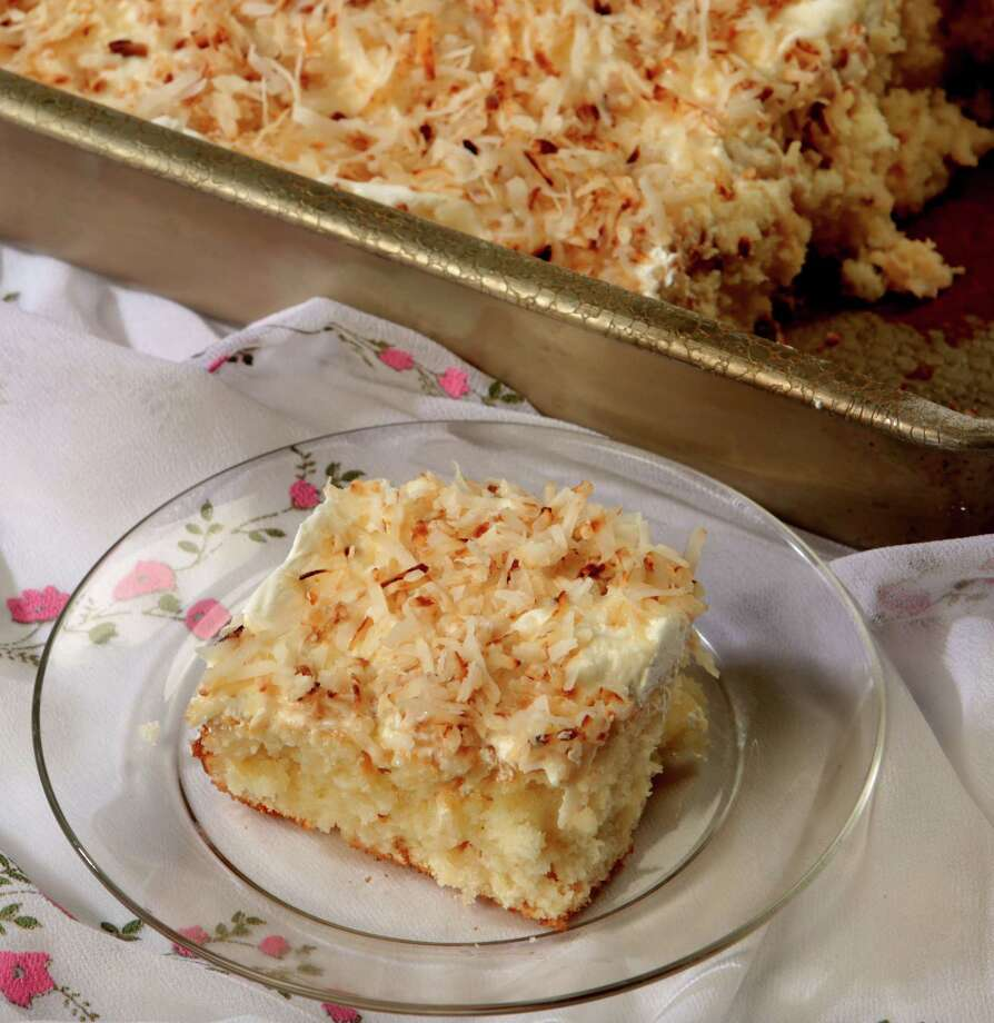 K2K photo of a coconut cream poke cake photographed in the studio at the Houston Chronicle, Tuesday, April 7, 2015. (Billy Smith II / Houston Chronicle) Photo: Billy Smith II, Staff / © 2015 Houston Chronicle