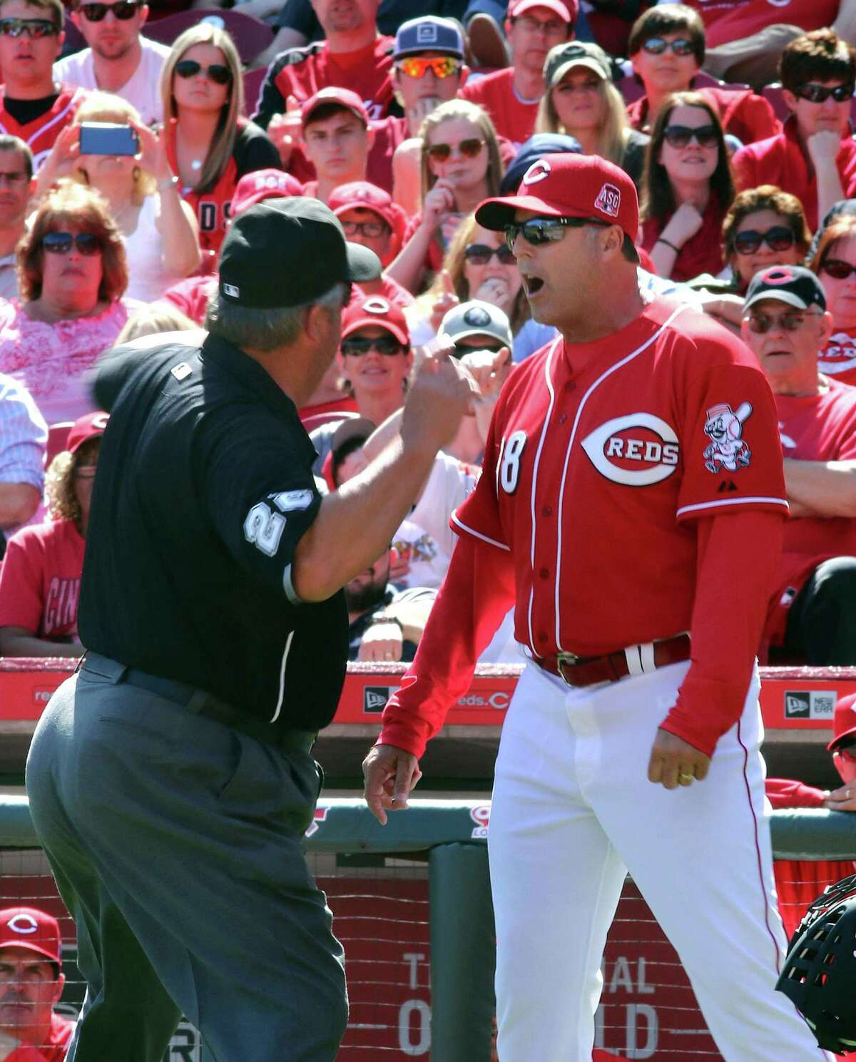 FILE - In this Sunday, April 12, 2015, file photo, Cincinnati Reds manager Bryan Price is ejected by umpire Joe West while arguing a call against the St. Louis Cardinals in the seventh inning of a baseball game, in Cincinnati. Price went on a profanity-filled rant during his pregame meeting with media, Monday, April 20, 2015, taking exception with the way his team was being covered.