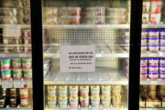 OVERLAND PARK, KS - APRIL 21:  Shelves are bare and signs are posted where Blue Bell products were displayed in a grocery store on April 21, 2015 in Overland Park, Kansas.  Blue Bell Creameries recalled all products following a Listeria contamination.