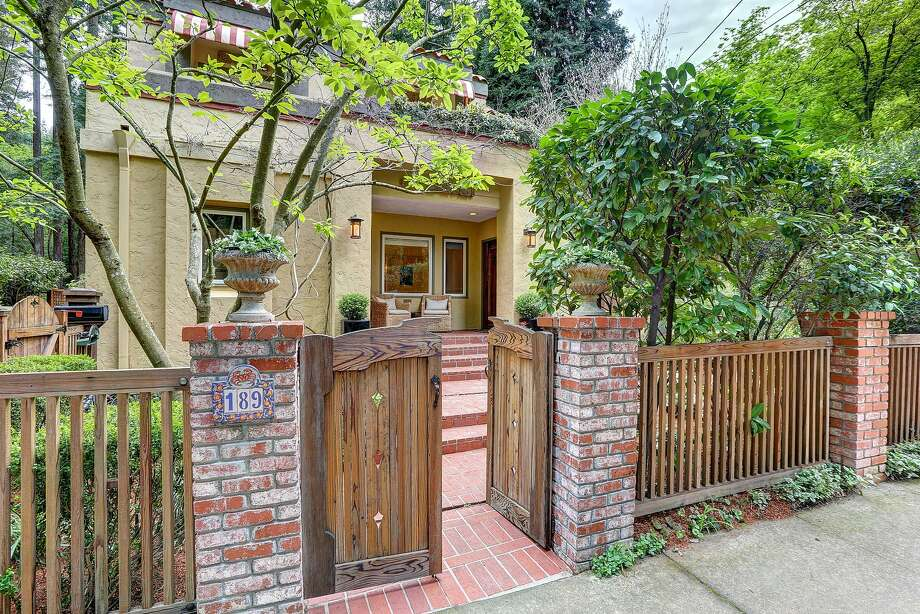 The Craftsman-style pedestrian gate was designed by Wayne Vergith.