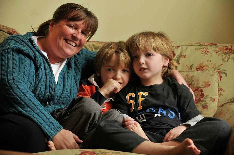 Lindsey Clark and her six-year-old twin boys Jeremy (in stripes) and Miles pose for a photograph recently in their home in Darien. Jeremy and Miles have Dravet syndrome, a form of childhood epilepsy. Their mother would like to give them medical marijuana, which has been found to lessen, and in some instances eliminate, seizures associated with the syndrome. Photo: Jason Rearick / Stamford Advocate
