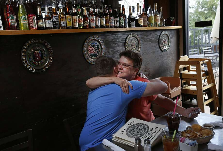 Dorie Stafford hugs her grandson Kyle Davis, 20, who came for a surprise visit from Oregon to see her at El Azteca restaurant Feb. 7, 2015 in Ukiah, Calif. Stafford, who is on Social Security, moved in with her longtime friends in Ukiah over a year ago because she couldn't afford a place of her own. The home does not have electricity, and though Stafford respects the lifestyle her friends choose to have, she says she wishes she could have her own place and electricity. Her husband Wayne died in 2007 in a motorcycle accident, three years after filing a disability claim with the Oakland VA for the time he spent serving in the Korean War which involved exposure to Agent Orange. Wayne never received a response from the VA while he was alive. Photo: Leah Millis, The Chronicle