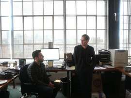 John Peterson (right), founder and president of Public Architecture, confers with Zach Reisler in the non-profit's office space in San Francisco, Calif. on Tuesday, April 21, 2015.