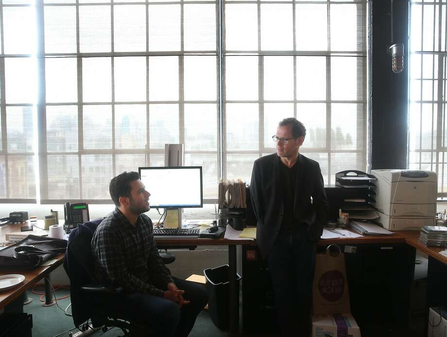 John Peterson (right), founder and president of Public Architecture, confers with Zach Reisler in the non-profit's office space in San Francisco, Calif. on Tuesday, April 21, 2015. Photo: Paul Chinn, The Chronicle