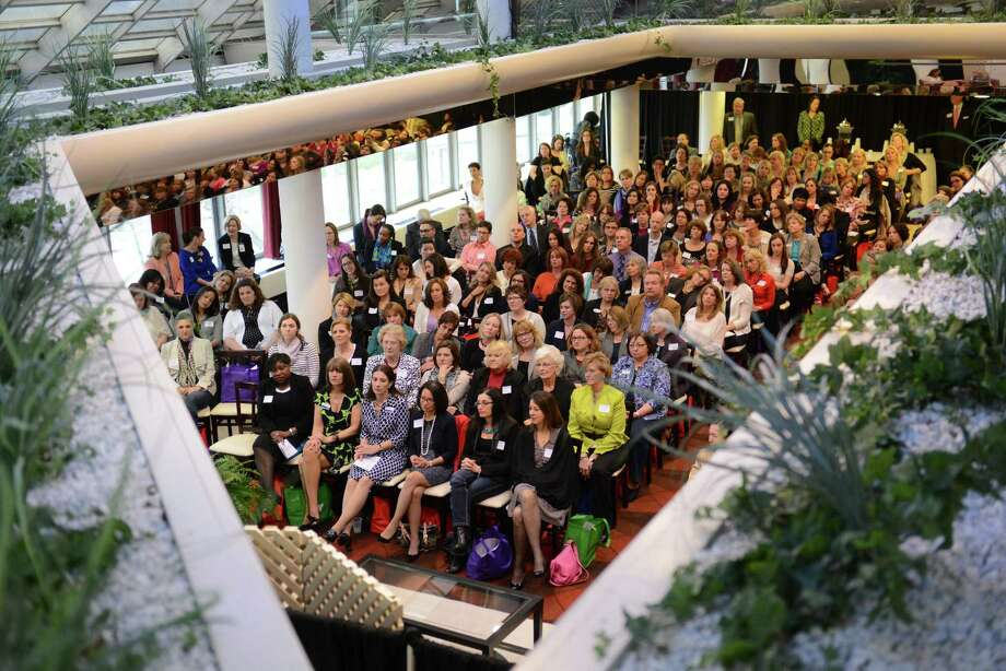 Hundreds listen to the Women's Business Council's third annual Conversations with Extraordinary Women panel discussion at the Matrix Conference & Banquet Center. This year's lineup features  President & CEO of the Ms. Foundation for Women, Teresa Younger, New York Times Bestselling Author & Founder of Sneaky Chef Foods, Missy Chase Lapine, Executive Editor of CTbites, Amy Kundrat, and the Director of Global Diversity & Inclusion at Praxair, Moderator Vanessa Abrahams-John. Photo: Tyler Sizemore / The News-Times