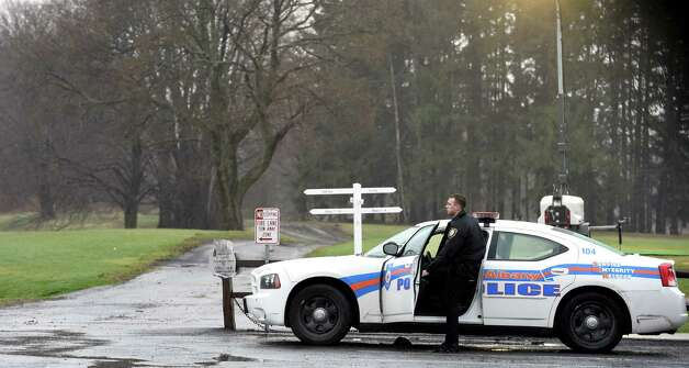 An Albany Police officer secures the entry point to the Capital Hill at Albany Golf Course Tuesday morning April 21, 2015 to limit access to the course due to the mudslide on the Normans Kill that borders Albany and Bethlehem, N.Y.       (Skip Dickstein/Times Union) Photo: SKIP DICKSTEIN / 00031544A
