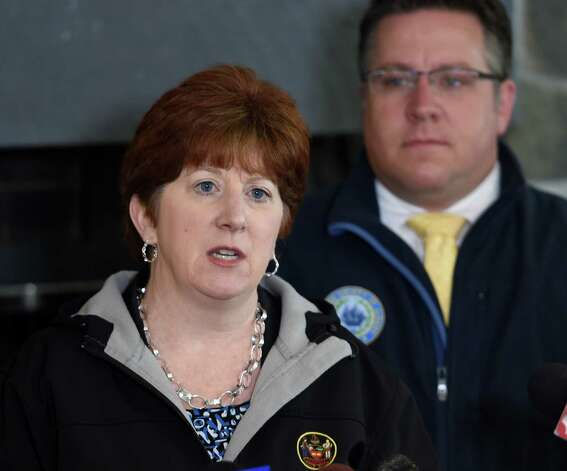 Albany Mayor Kathy Sheehan speaks about the extraordinary job that was done at Capital Hill at Albany Golf Course Tuesday morning April 21, 2015 to make repairs from the mudslide on the Normaskill Creek that borders Albany and Bethlehem, N.Y.   Joining Sheehan was Albany County Executive Dan McCoy, background.    (Skip Dickstein/Times Union) Photo: SKIP DICKSTEIN / 00031544A