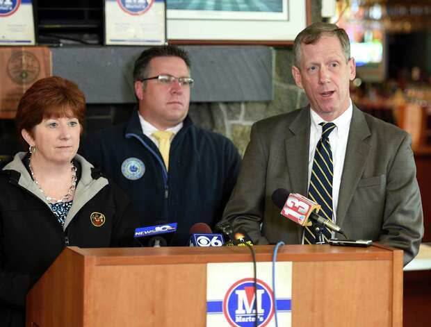 Bethlehem Supervisor John Clarkson, right joins Albany Mayor Kathy Sheehan, right as he speaks about the work done at Capital Hill at Albany Golf Course Tuesday morning April 21, 2015, to make repairs from the mudslide on the Normans Kill that borders Albany and Bethlehem, N.Y.   Joining Sheehan and Clarkson was Albany County Executive Dan McCoy, background.    (Skip Dickstein/Times Union) Photo: SKIP DICKSTEIN / 00031544A