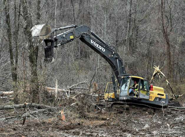 Excavators work in concert at the Capital Hill at Albany Golf Course Tuesday morning April 21, 2015 to make repairs at the mudslide site on the Normaskill Creek that borders Albany and Bethlehem, N.Y.       (Skip Dickstein/Times Union) Photo: SKIP DICKSTEIN / 00031544A