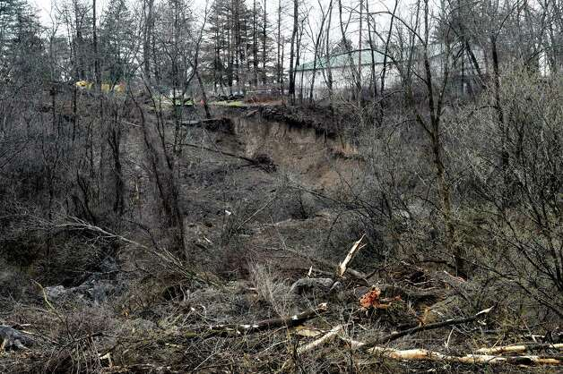 The actual site of the mudslide that began on the Bethlehem side of the Normanskill Creek and ended encroaching on the Capital Hill at Albany Golf Course Tuesday morning April 21, 2015 in Albany, N.Y.  (Skip Dickstein/Times Union) Photo: SKIP DICKSTEIN / 00031544A